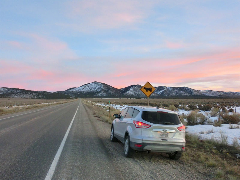 jackson to bryce roadtrip Ford Escape in sunset in Utah